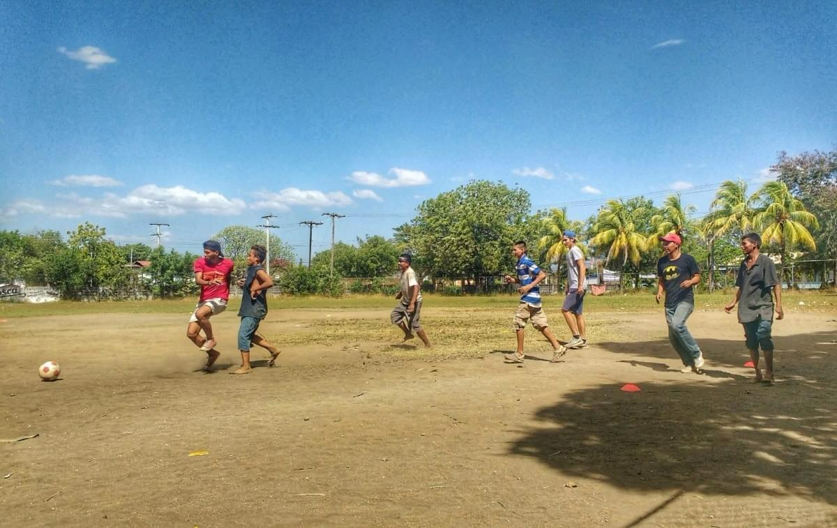 Local youth participating in a football game organised by Quetzaltrekkers in León, NIcaragua