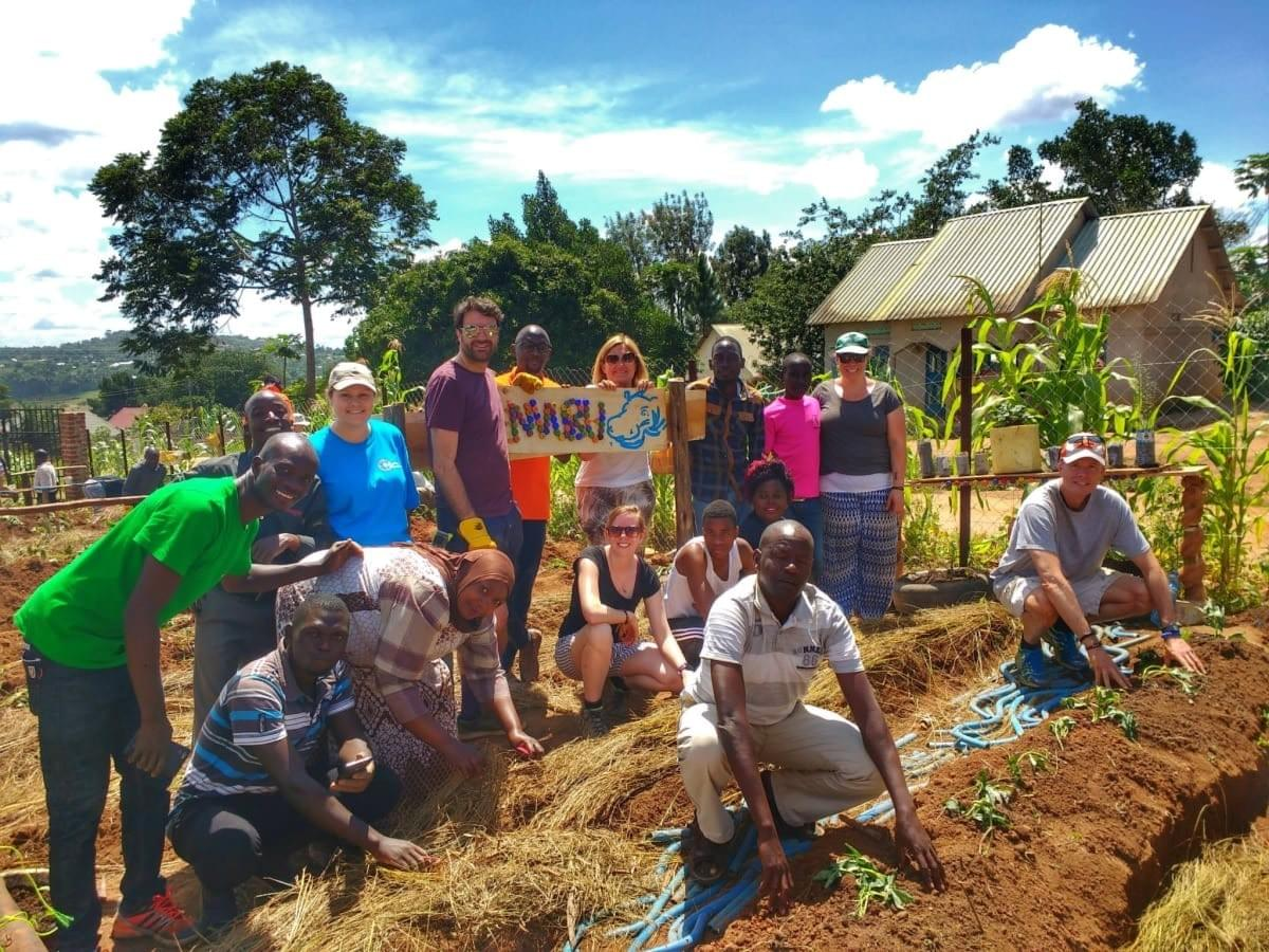 Uganda Marathon participants work with local community projects on a food farm initiative