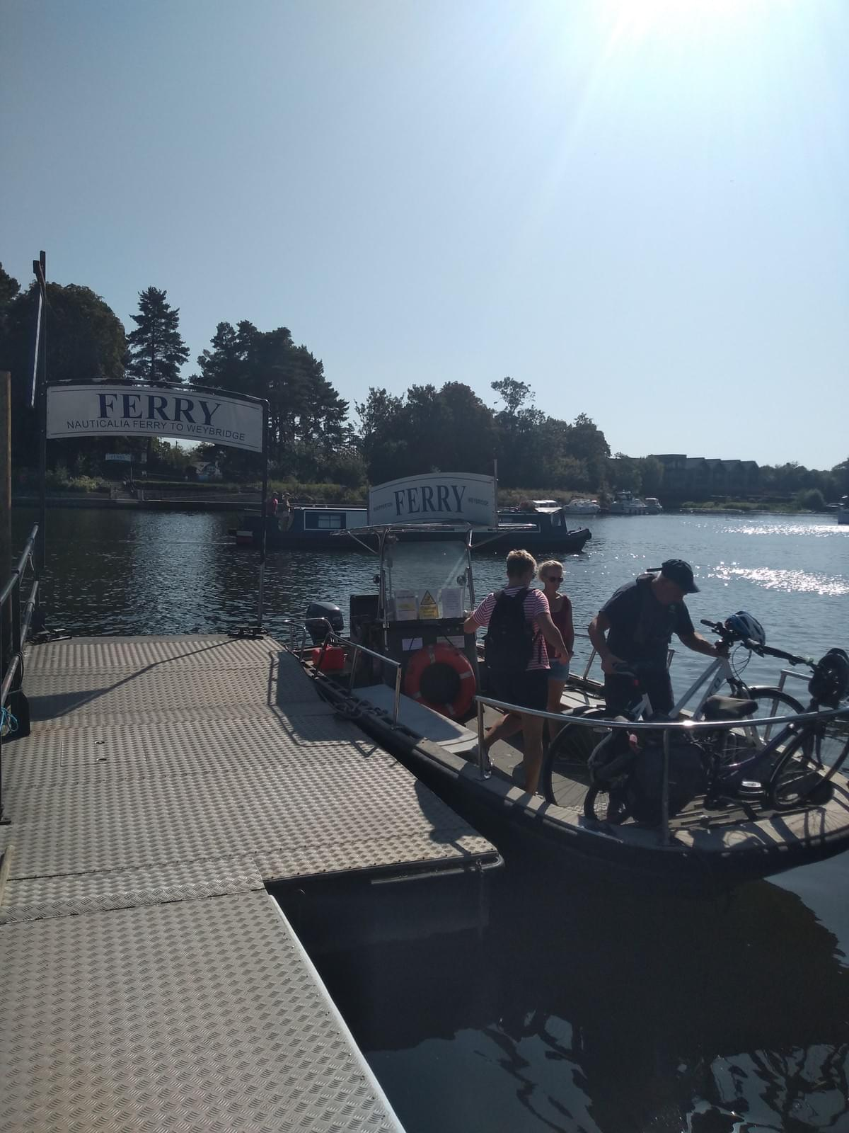 Group using the River Thames ferry crossing at Weybridge