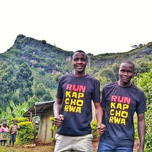 run kapchorwa team in on mount elgon in front of waterfall