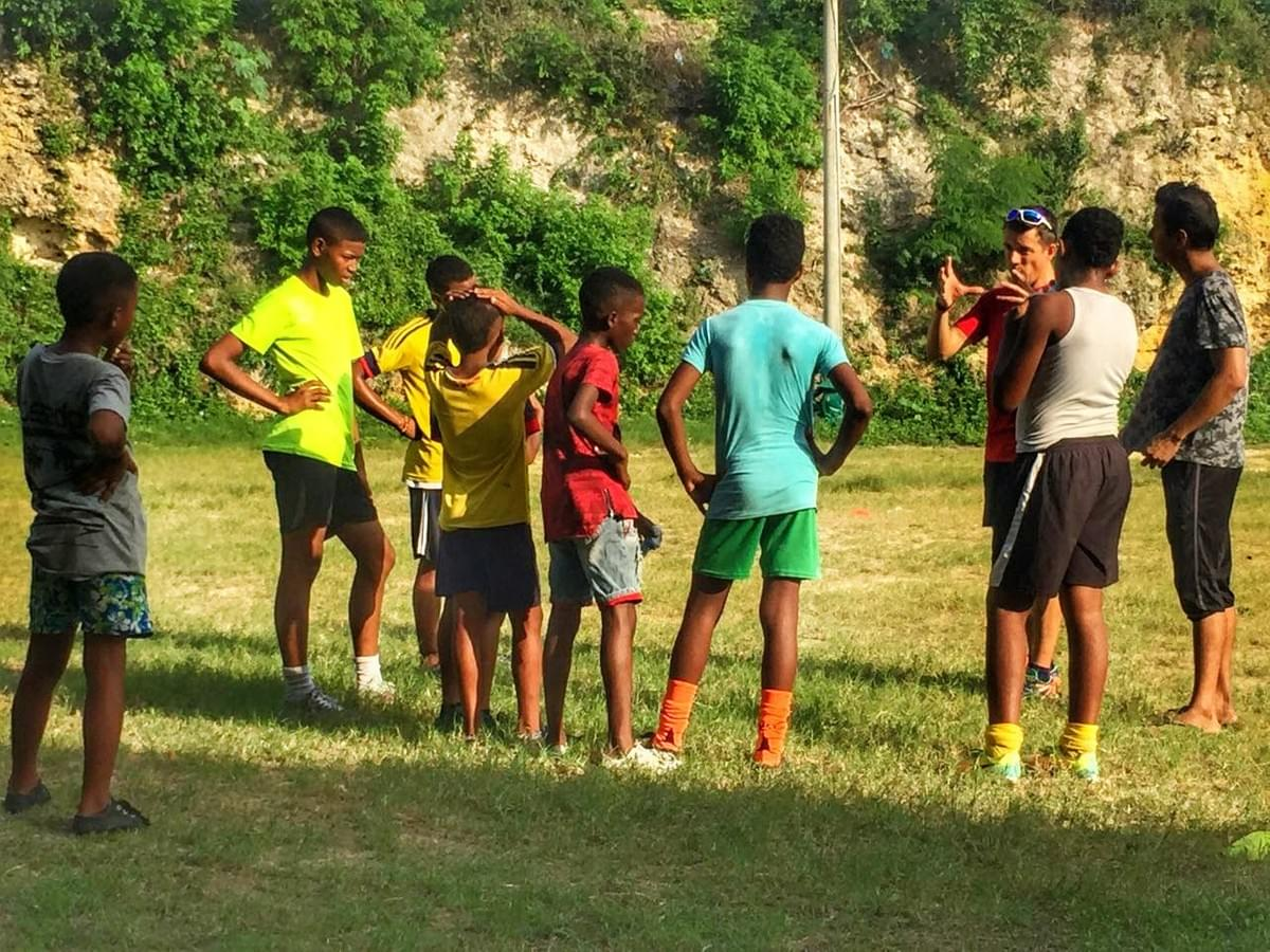 Local children listen in during a talk before a running session in Cartagena, Colombia