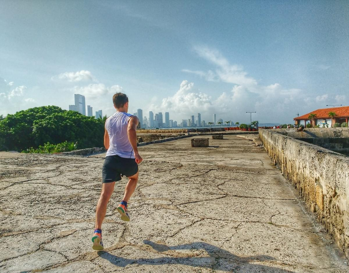 Running along the walls of Cartagena Old Town, cityscape in the background