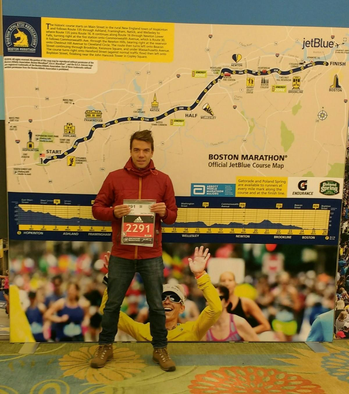Race number photo in front of 2018 Boston Marathon course map