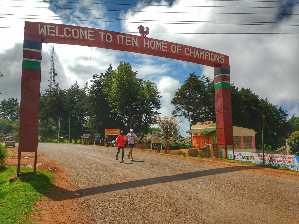 Running under the 'Home of Champions' arch in Iten, Kenya