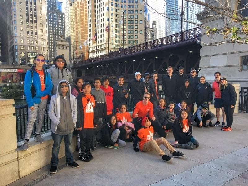 Group photo of participants on a Chicago Run Architecture Run at Chicago riverside