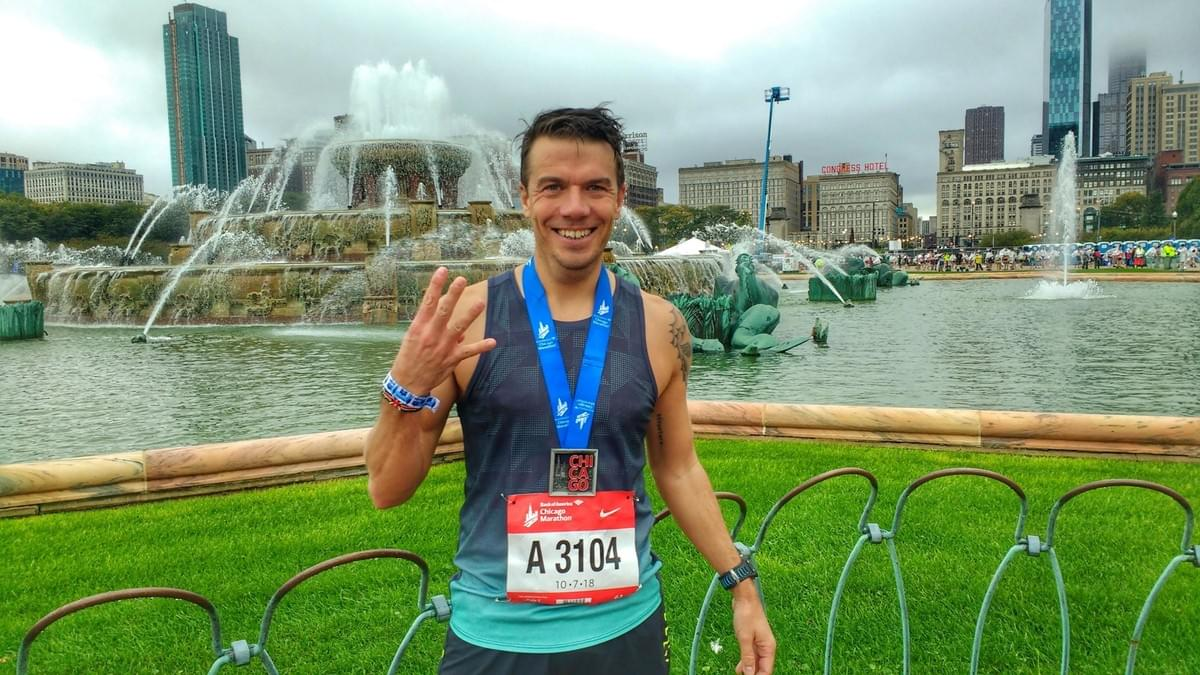 Taking a post-race photo with the medal at Chicago Marathon 2018