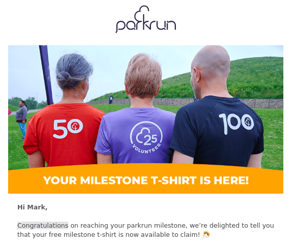 Two runners and a volunteer model the free parkrun 50 t-shirt, 100 t-shirt and 25 t-shirt