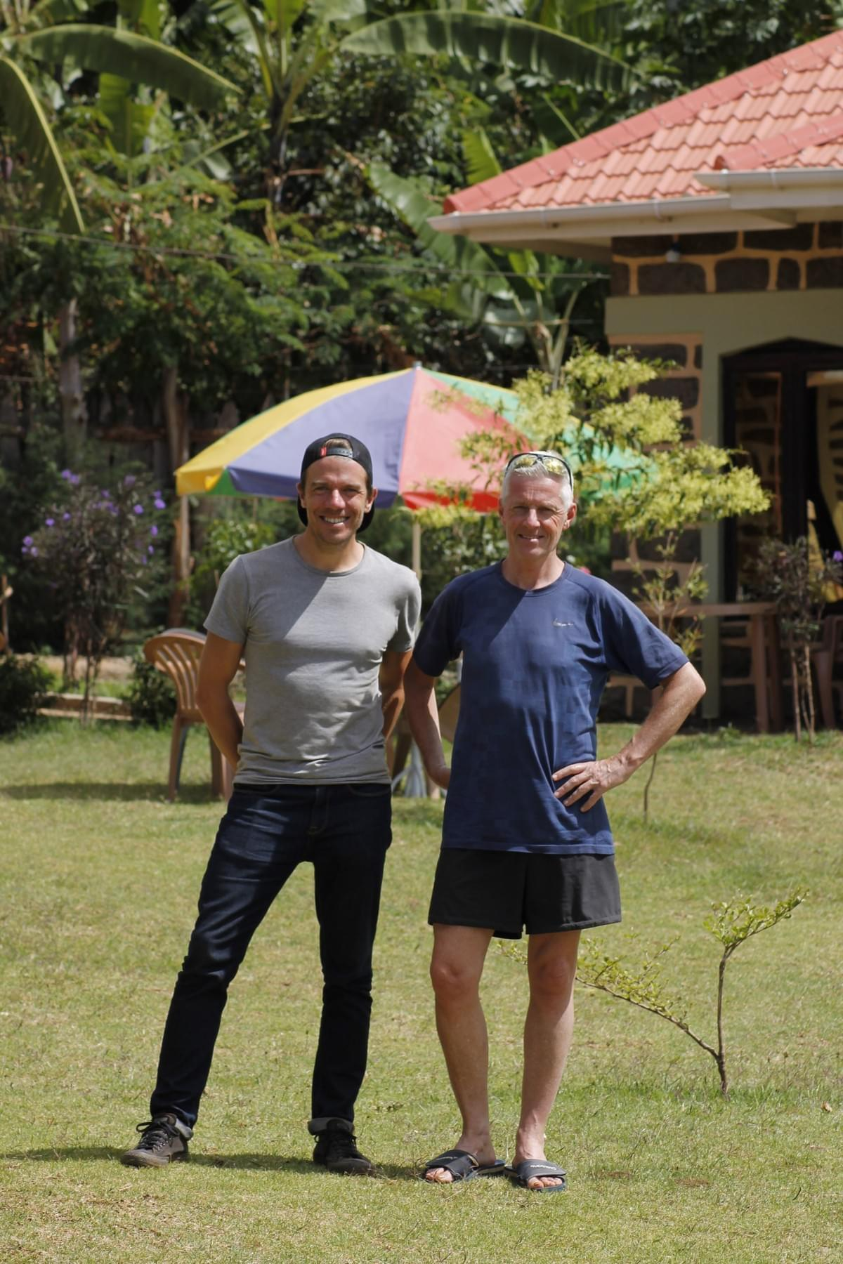 Mark from Adventures in Running and Addy Ruiter standing in a garden in Kapchorwa, Uganda