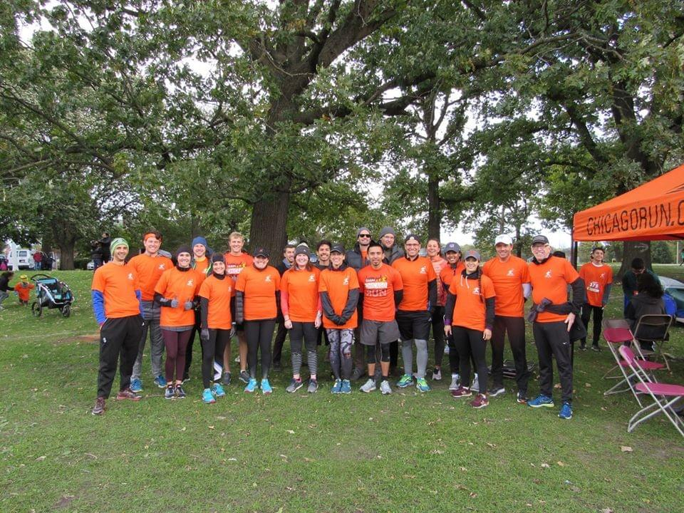 A group of Chicago Run volunteer runners gathered in Lincoln Park, Chicago before the 'Pumpkins in the Park' 5km run