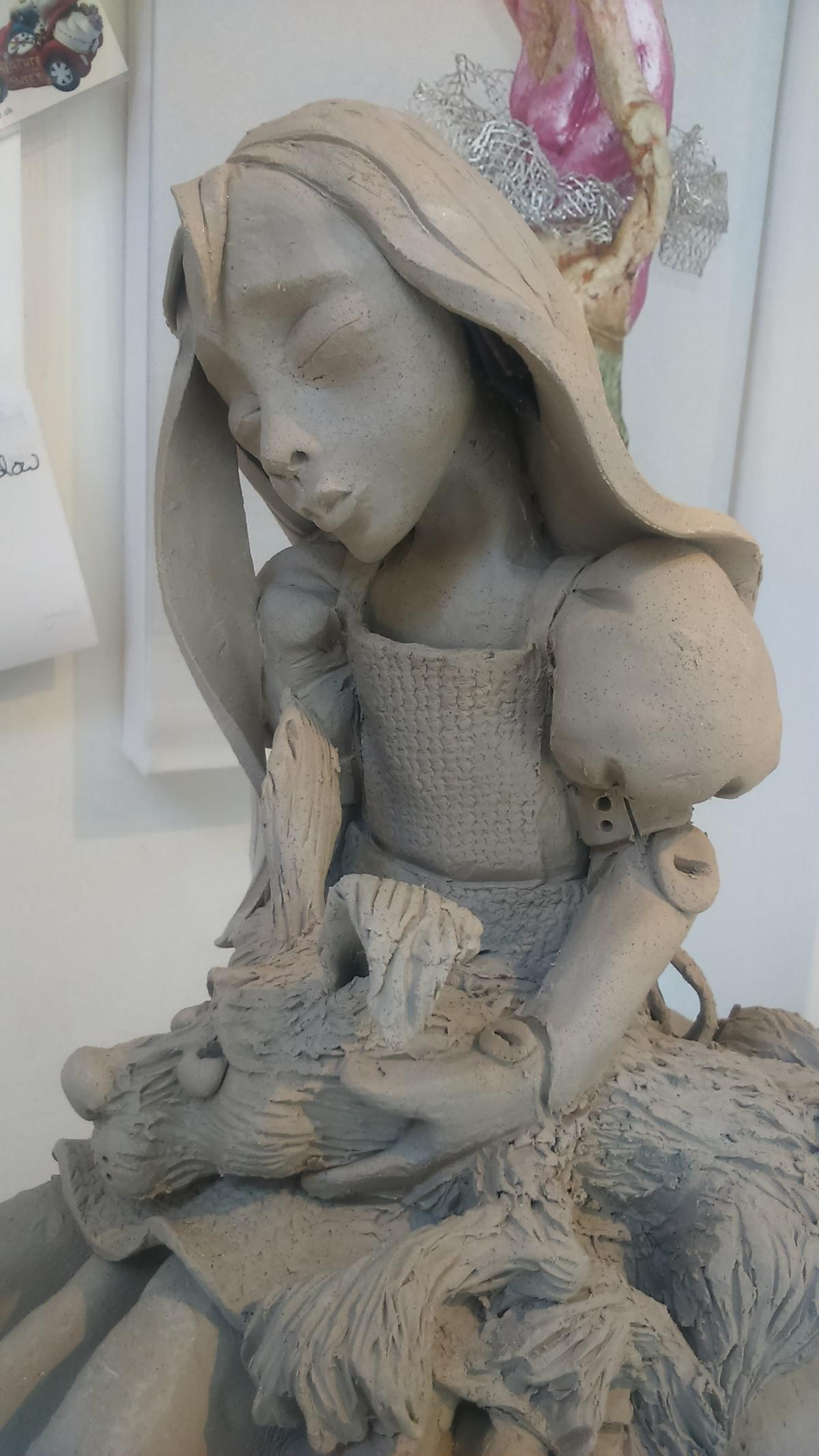 Girl with rabbit, clay sculpture by Heather Sweet-Moon