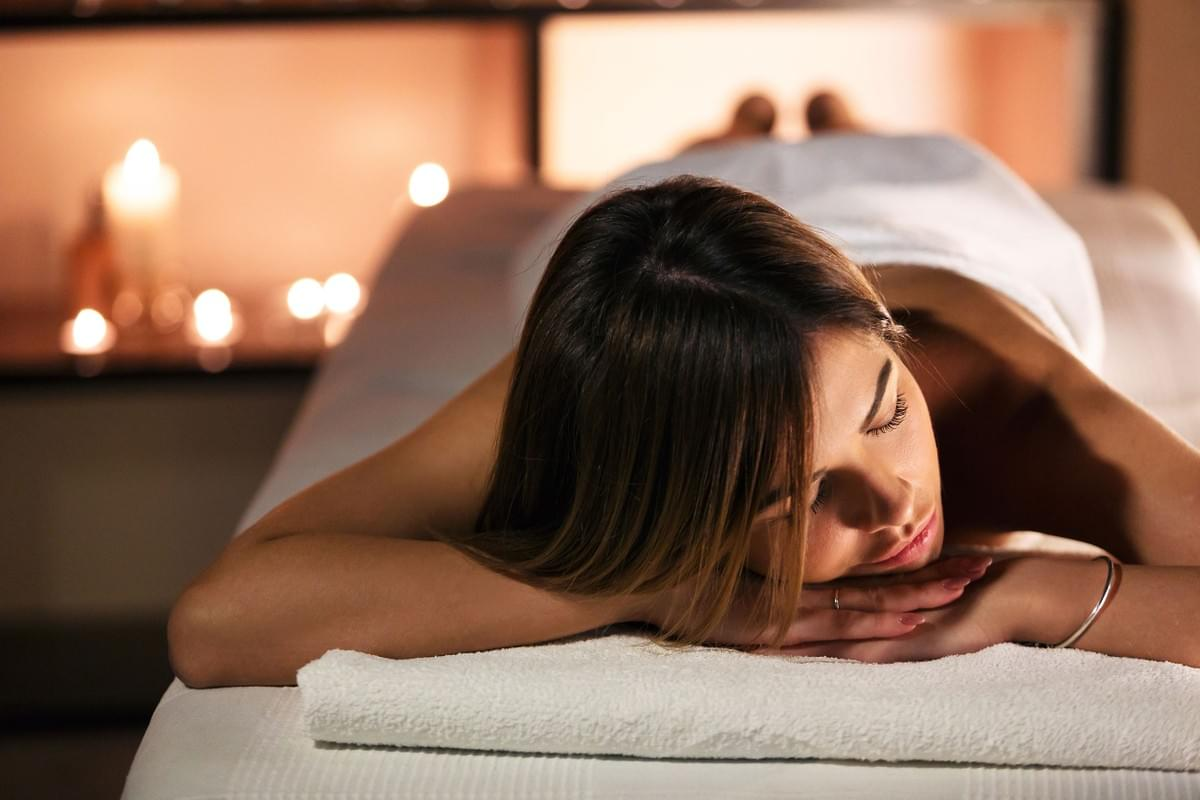 Relaxed Woman Laying Prone On Massage Table
