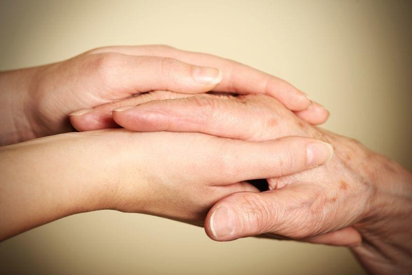 A Picture Of Young And Old Hands Touching