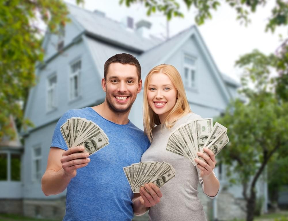 Happy Couple with money in their hands.  Get Cash for Your House in Rochester, NY