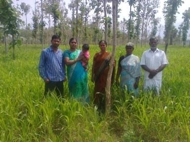 Mr. Govindaswarmy, TIST Farmer, and family