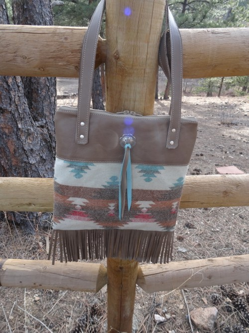 Leather and fabric handbag with concho.