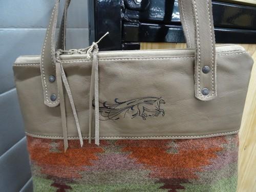 Leather and fabric handbag.
