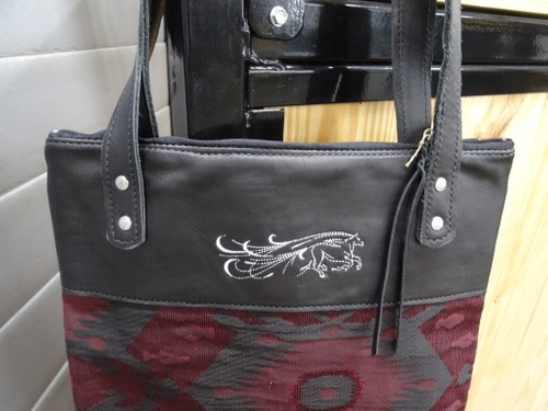 Leather and fabric handbag with embroidered horse.