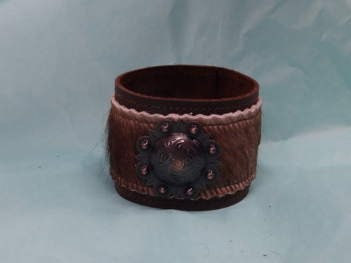 Leather bracelet with hair on hide and berry concho.