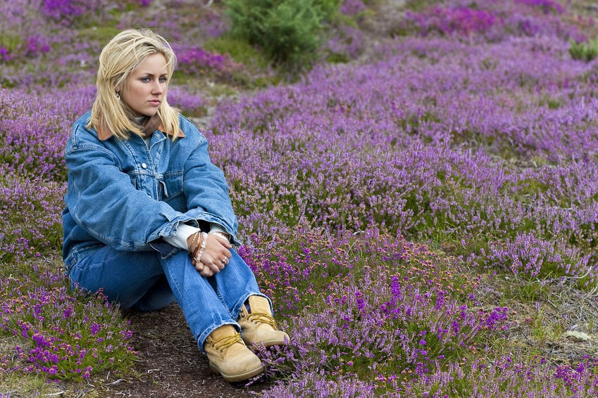 Sad Woman Sitting In Field Of Lavender