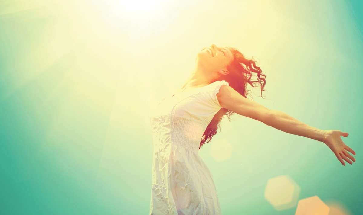 Happy Woman Outside With Arms Stretched Open To Sky