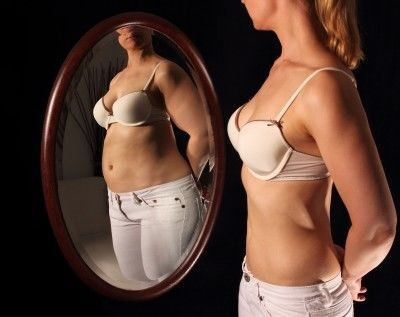 Girl With Poor Body Image Looking at Self in Mirror